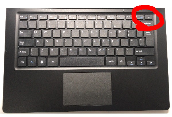 Power button on PBP's keyboard, in place of delete key, at top right corner of keyboard, as an actual keyboard key (official image from Pine64 Store, modified with circle around power button)