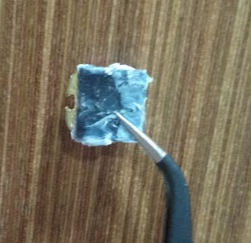 Yubikey 4 nano partially covered in aforementioned gooey substance, but drier now as it stayed out of acetone for a while