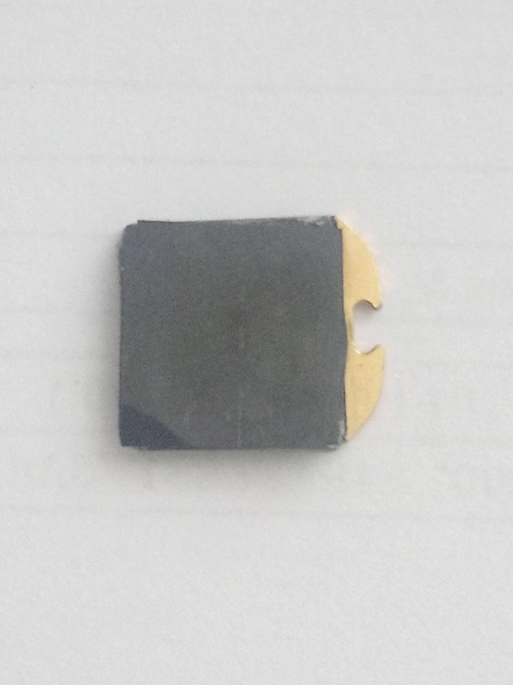 Shiny black layers covering the back of the Yubikey 4 nano
